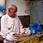 Postcard from an Omani Tobacco seller
