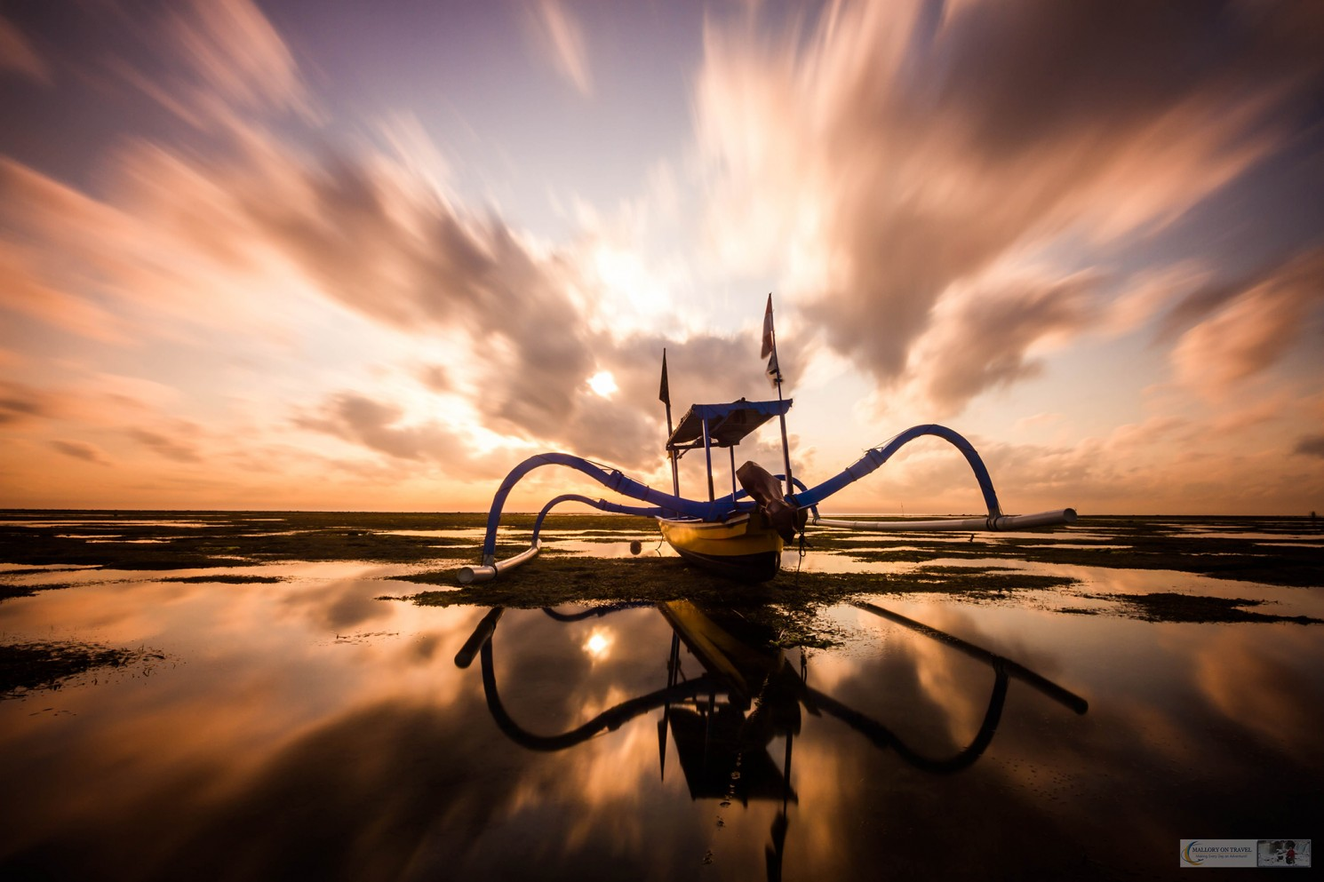 An outrigger boat under dynamic skies at sunrise on Sanur Beach, Ubud in Bali, Indonesia on Mallory on Travel adventure travel, photography, travel Iain Mallory_Indonesia_1389