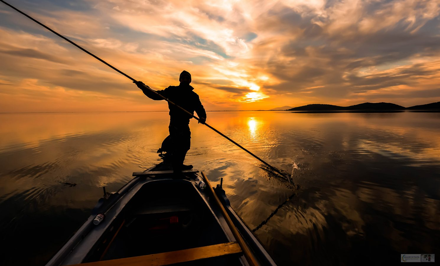Travel inspiration; A fisherman in the Messolonghi Lagoon of western Greece on Mallory on Travel adventure travel, photography, travel Iain Mallory_Greece8384-163