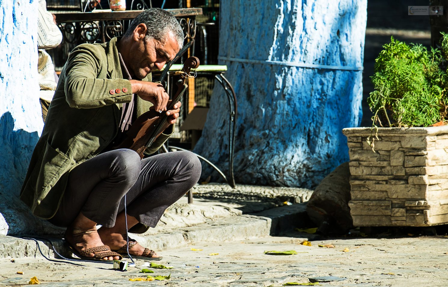 Fiddle playing performer on the streets of Chefchaouen, a town in the Rif Mountains of northern Morocco in north Africa on Mallory on Travel adventure travel, photography, travel Iain Mallory_Morocco 029