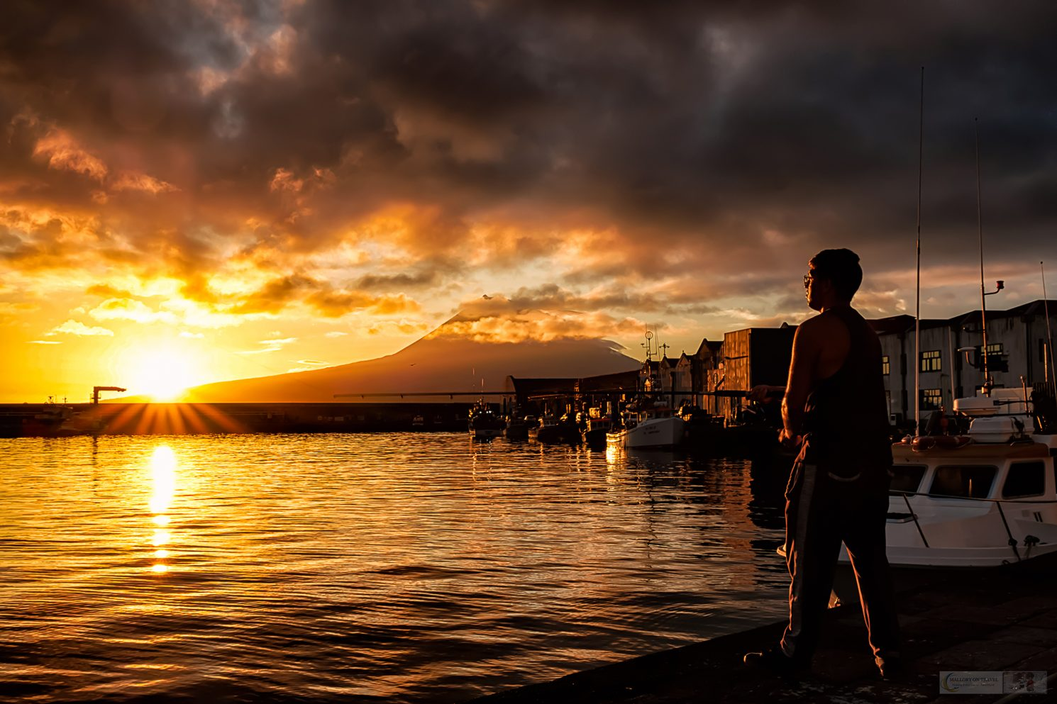 A fisherman at sunrise in the port of Horta on the island of Faial, in the Azores archipelago, Portugal in the Atlantic Ocean on Mallory on Travel adventure travel, photography, travel Iain Mallory_azores-1
