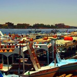 Postcard from a colourful Egyptian Nile; boats and feluccas