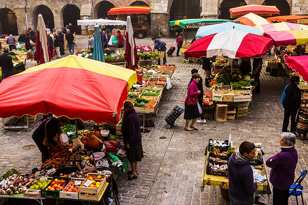 The markets of Villefrance-de-Rouergue in Place Notre Dame in the Aveyron region of France on Mallory on Travel adventure, adventure travel, photography Iain_Mallory_Ave1403186 villefrance_de_rouergue