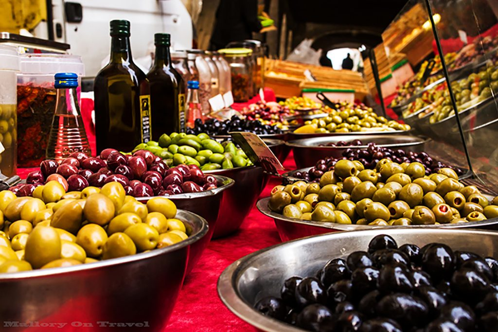 Olive stall on the markets of Villefrance-de-Rouergue in Place Notre Dame in the Aveyron region of France on Mallory on Travel adventure, adventure travel, photography Iain_Mallory_Ave1403234 villefrance_de_rouergue