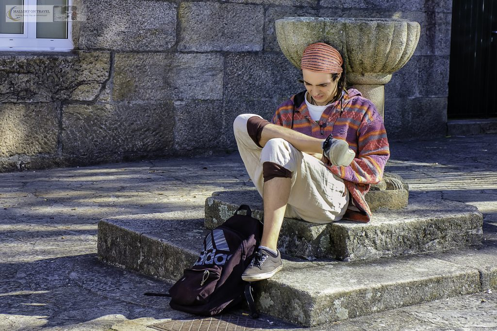 A peregrino or modern day pilgrim on the Camino de Santiago or Way of St James relaxing in a square in the Galicia capital Santiago de Compostela on Mallory on Travel adventure travel, photography, travel Iain Mallory_spain 001-3