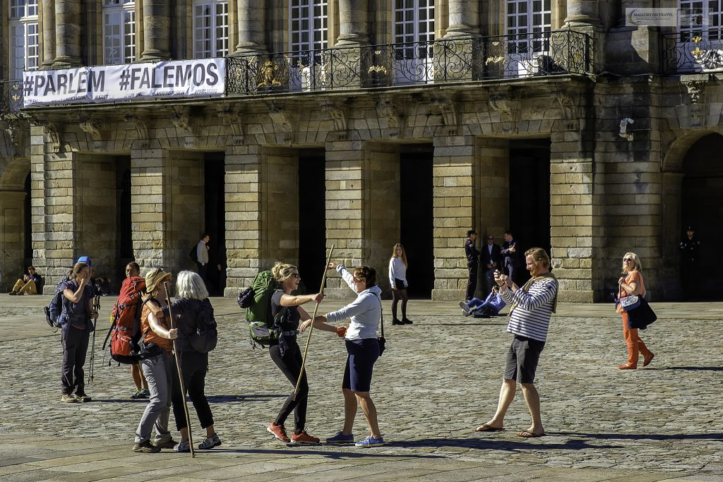 Peregrinos greeting one another in Obradoiro Square, Santiago de Compostela in Galicia, northern Spain on Mallory on Travel adventure travel, photography, travel Iain Mallory_spain 006-3