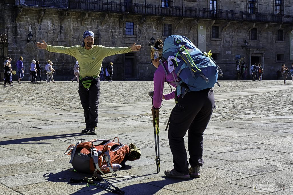 Peregrinos, the modern pilgrims at the finish of the Camino de Santiago, Way of St James posing in Obradoiro Square in the Galician capital city of Santiago de Compostela in the northern region of Green Spain on Mallory on Travel adventure travel, photography, travel Iain Mallory_spain 018-2