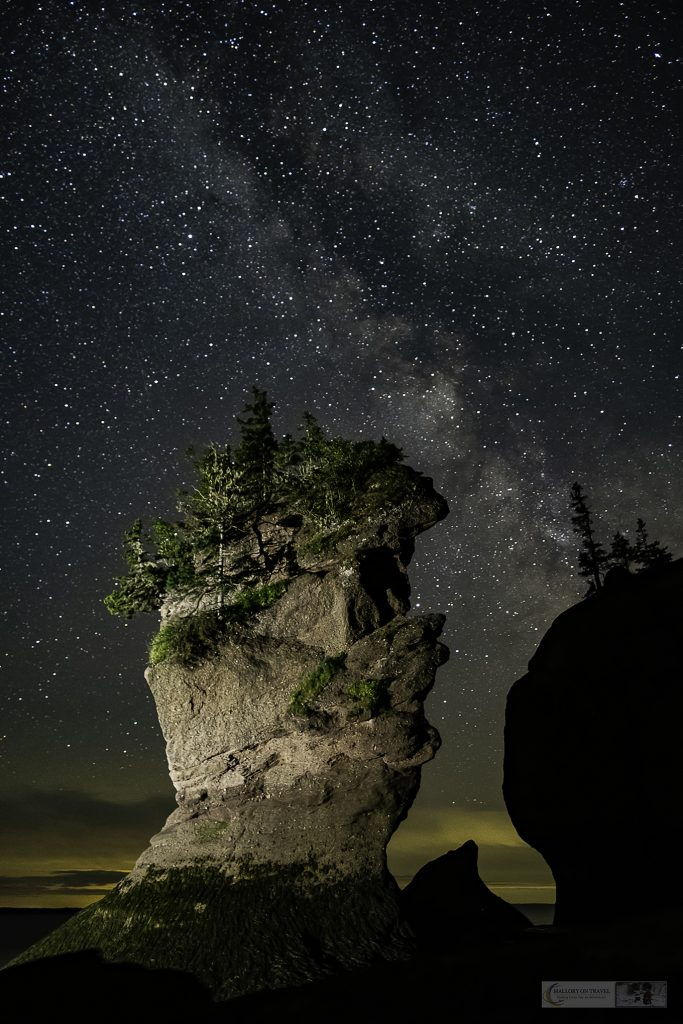 The Milky Way over one of the sea stacks at Hopewell Rocks on the Bay of Fundy, home of the largest tidal range in the world in the Canadian maritime province of New Brunswick on Mallory on Travel adventure travel, photography, travel